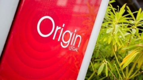 The Origin legal sign